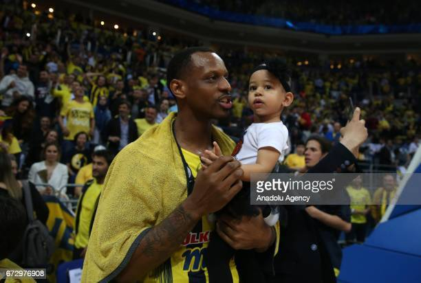 James Nunnally of Fenerbahce celebrates with his son after their victory at the end of the Turkish Airlines Euroleague playoffs match between...