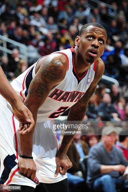 James Nunnally of the Atlanta Hawks stands on the court against the San Antonio Spurs on January 24 2014 at Philips Arena in Atlanta Georgia NOTE TO...