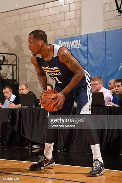 James Nunnally of the Indiana Pacers looks to pass the ball against the Miami Heat during the Samsung NBA Summer League 2014 on July 10 2014 at Amway...