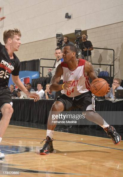 James Nunnally of the Miami Heat faces Kyle Singler of the Detroit Pistons during the 2013 Southwest Airlines Orlando Pro Summer League between the...