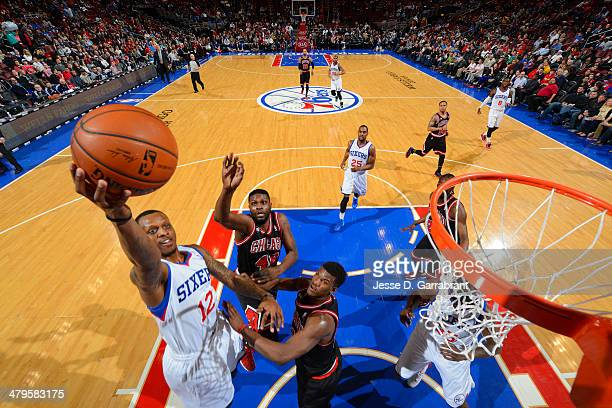 James Nunnally of the Philadelphia 76ers goes up for the layup against the Chicago Bulls at the Wells Fargo Center on March 19 2014 in Philadelphia...