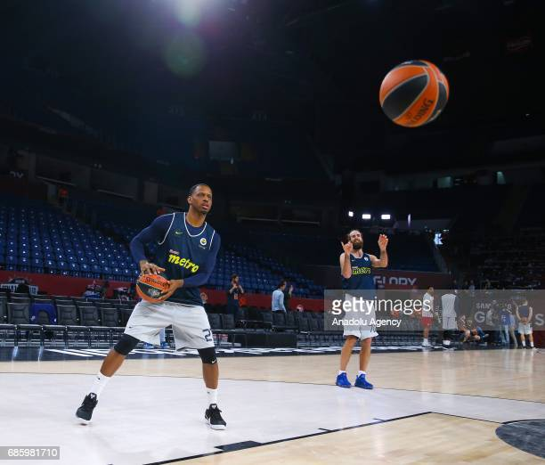 James Nunnaly and Luigi Datome of Fenerbahce attend a training session ahead of the Turkish Airlines Euroleague Final Four final match between...