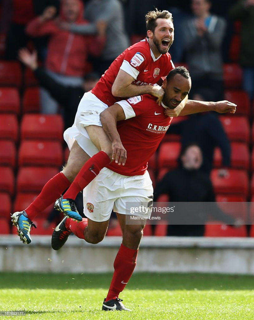 James O'Brien of Barnsley congratulates Chris O'Grady on his goalduring the npower Championship match between Barnsley and Hull City at Oakwell Stadium on April 27, 2013 in Barnsley, England.