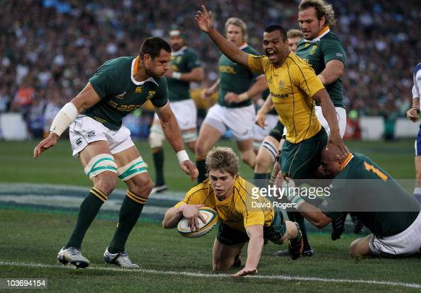James O'Connor of Australia dives over for the second try during the 2010 TriNations match between the South African Springboks and the Australian...