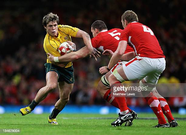 James O'Connor of Australia is tackled by Ian Evans of Wales during the Test match between Wales and the Australian Wallabies at Millennium Stadium...