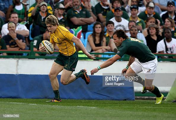 James O'Connor of Australia races away from Francois Hougaard to score his second try during the 2010 TriNations match between the South African...