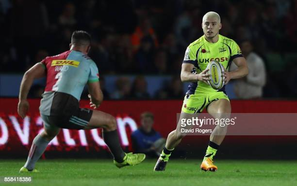 James O'Connor of Sale takes on Dave Ward during the Aviva Premiership match between Harlequins and Sale Sharks Sharks at Twickenham Stoop on October...