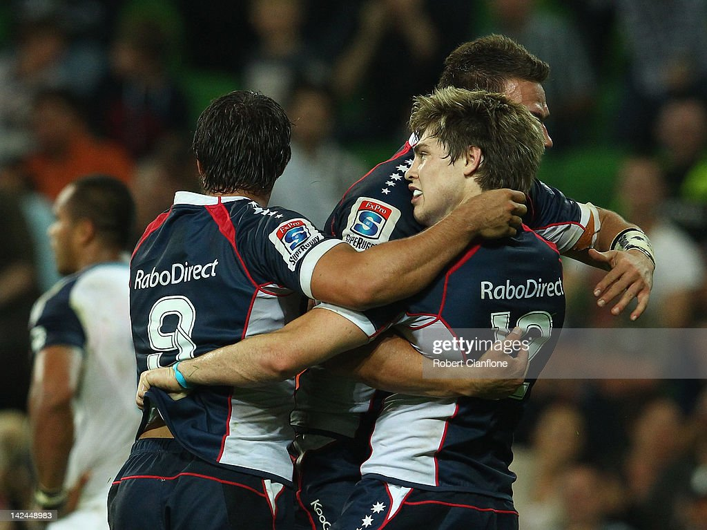 James O'Connor of the Rebels celebrates with Nick Phipps and Mitch Inman after he scored during the round seven Super Rugby match between the Melbourne Rebels and the Auckland Blues at AAMI Park on April 5, 2012 in Melbourne, Australia.