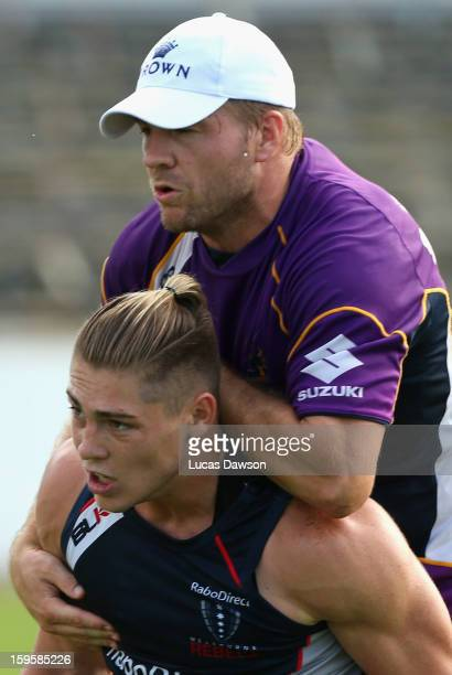 James O'Connor of the Rebels collides with Ryan Hinchcliffe of the Storm during a Melbourne Storm and Melbourne Rebels training session at Visy Park...