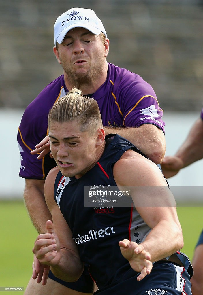 James O'Connor of the Rebels collides with Ryan Hinchcliffe of the Storm during a Melbourne Storm and Melbourne Rebels training session at Visy Park on January 17, 2013 in Melbourne, Australia.