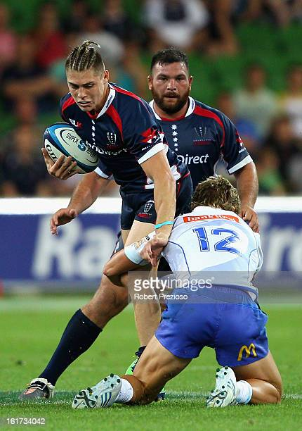James O'Connor of the Rebels is tackled by Kyle Godwin of the Force during the round one Super Rugby match between the Rebels and the Force at AAMI...