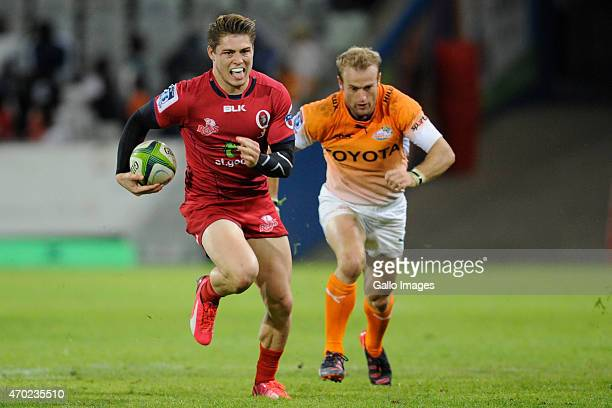 James O'Connor of the Reds and Sarel Pretorius of the Toyota Cheetahs during the Super Rugby match between Toyota Cheetahs and Reds at Free State...