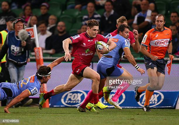 James O'Connor of the Reds makes a break past Luke Burton of the Force during the round 16 Super Rugby match between the Western Force and the...