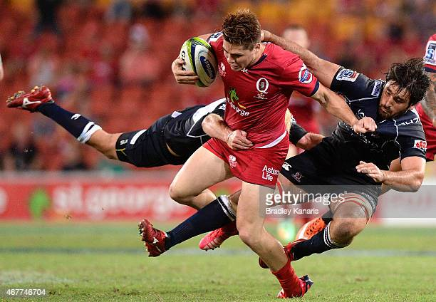 James O'Connor of the Reds takes on the defence during the round seven Super Rugby match between the Reds and the Lions at Suncorp Stadium on March...