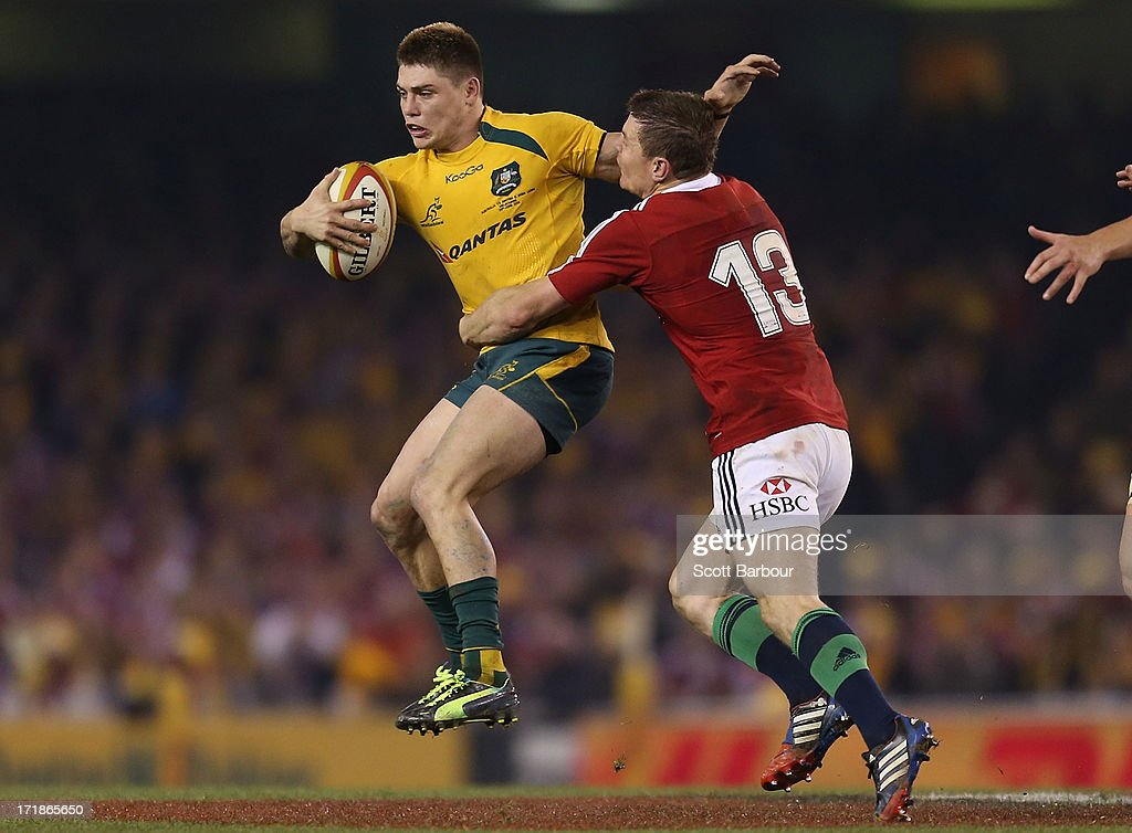 James O'Connor of the Wallabies is tackled by Brian O'Driscoll of the Lions during game two of the International Test Series between the Australian Wallabies and the British & Irish Lions at Etihad Stadium on June 29, 2013 in Melbourne, Australia.