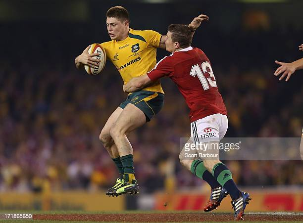 James O'Connor of the Wallabies is tackled by Brian O'Driscoll of the Lions during game two of the International Test Series between the Australian...