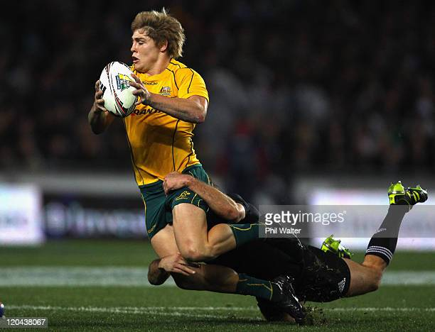 James O'Connor of the Wallabies is tackled by Conrad Smith of the All Blacks during the TriNations Bledisloe Cup match between the New Zealand All...
