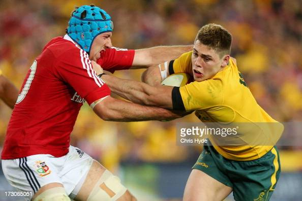 James O'Connor of the Wallabies is tackled by Justin Tipuric of the British Irish Lions during the International Test match between the Australian...