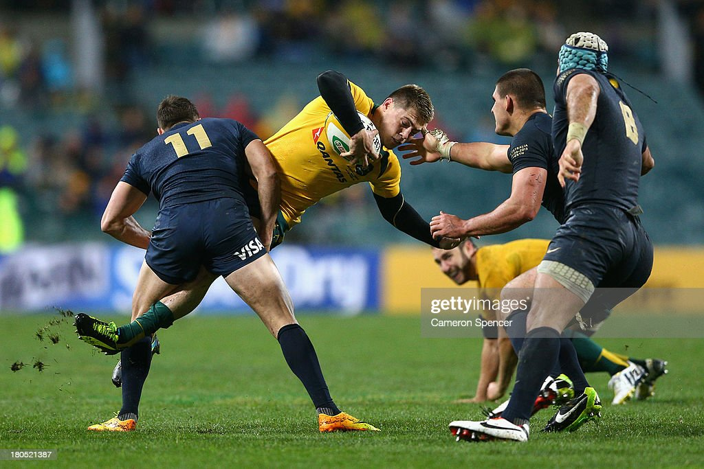 James O'Connor of the Wallabies is tackled during The Rugby Championship match between the Australian Wallabies and Argentina at Patersons Stadium on September 14, 2013 in Perth, Australia.
