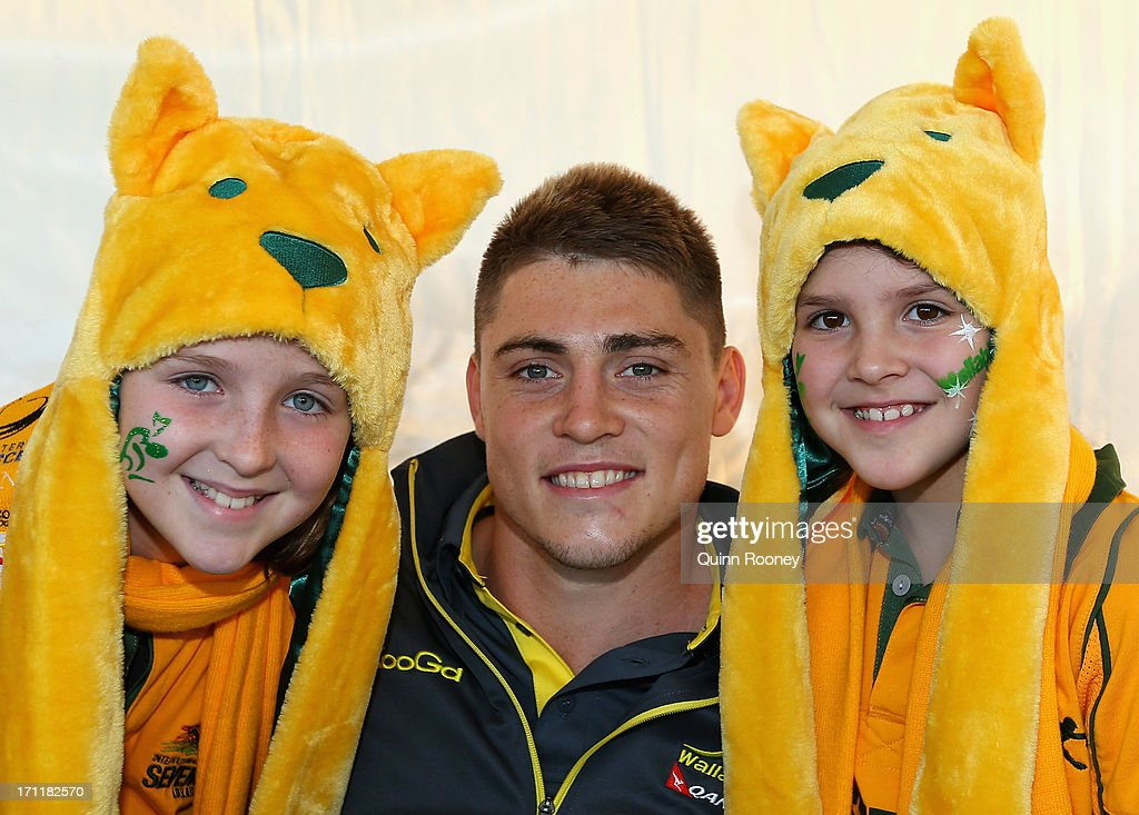 James O'Connor of the Wallabies poses with fans Grace and Ella Reynolds during an Australian Wallabies fan day on June 23, 2013 in Melbourne, Australia.