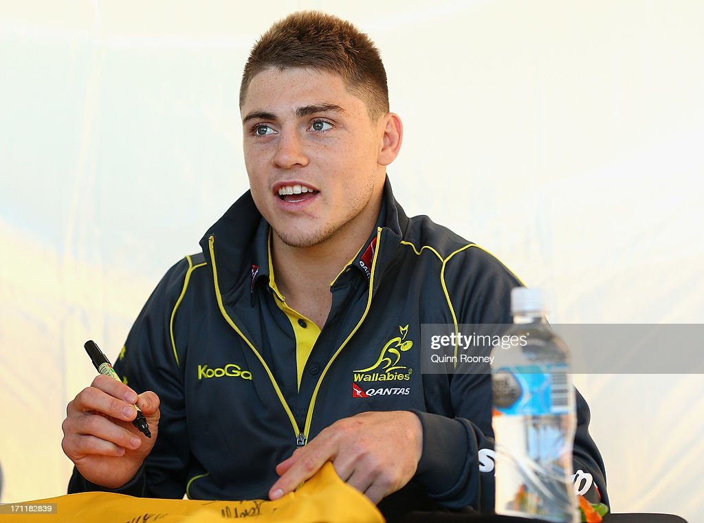 James O'Connor of the Wallabies signs autographs during an Australian Wallabies fan day on June 23, 2013 in Melbourne, Australia.
