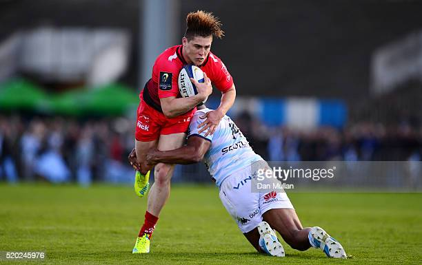 James O'Connor of Toulon is tackled by Joe Rokocoko of Racing 92 during the European Rugby Champions Cup Quarter Final between Racing 92 and RC...