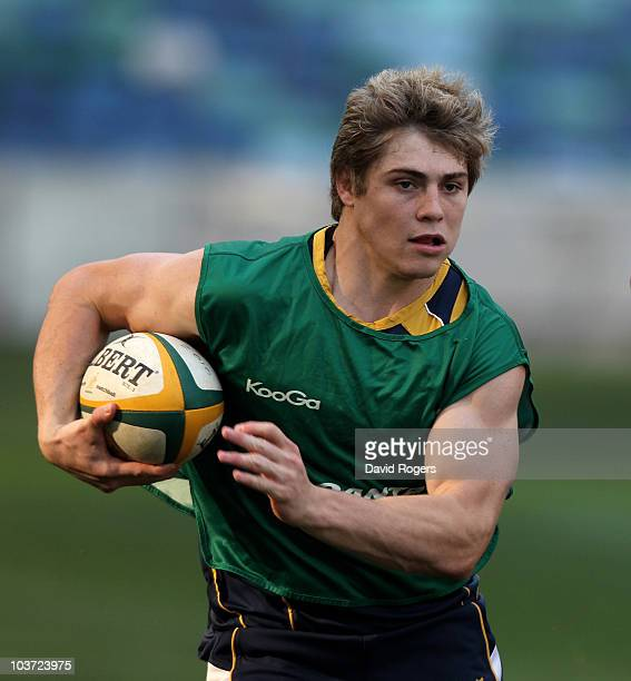 James O'Connor runs with the ball during an Australian Wallabies training session at the Moses Mahiba Stadium on August 30 2010 in Durban South Africa
