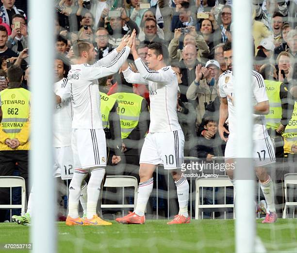 James of Real Madrid celebrate his score during the La Liga match between Real Madrid and Malaga at Estadio Santiago Bernabeu in Madrid Spain on...