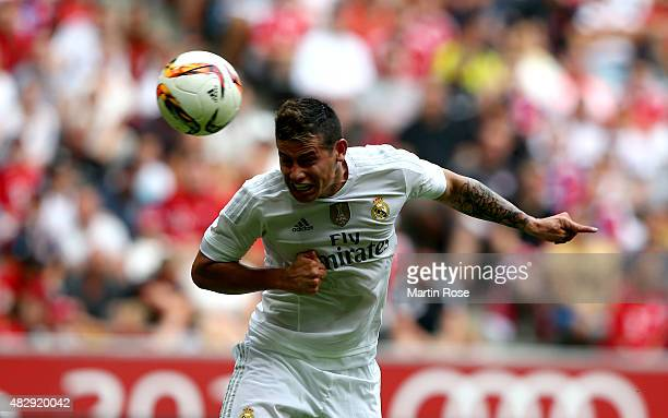 James of Real Madrid heads the opening goal during the Audi Cup 2015 match between Real Madrid and Tottenham Hotspur at Allianz Arena on August 4...