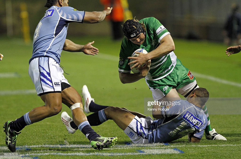 James Oliver of Manawatu is taken down by Dan Caprice of Northland during the round four ITM Cup match between Northland and Manawatu at Toll Stadium on September 5, 2012 in Whangarei, New Zealand.
