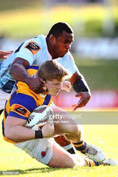 James O'Reilly of Bay of Plenty is taken down by Jone Macilai of Northland during the round one Mite 10 Cup match between Northland and Bay of Plenty...