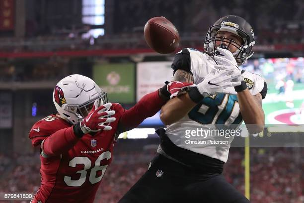 James O'Shaughnessy of the Jacksonville Jaguars is unable to complete the pass against Budda Baker of the Arizona Cardinals in the second half at...
