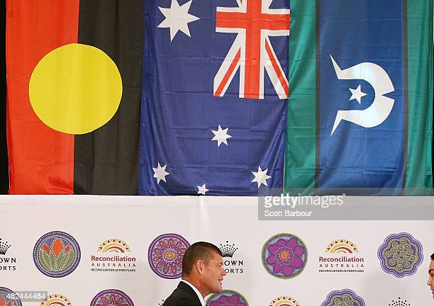 James Packer Crown Resorts Chairman walks on stage under an Australian Aboriginal Flag an Australian Flag and a Torres Strait Islander flag as he...
