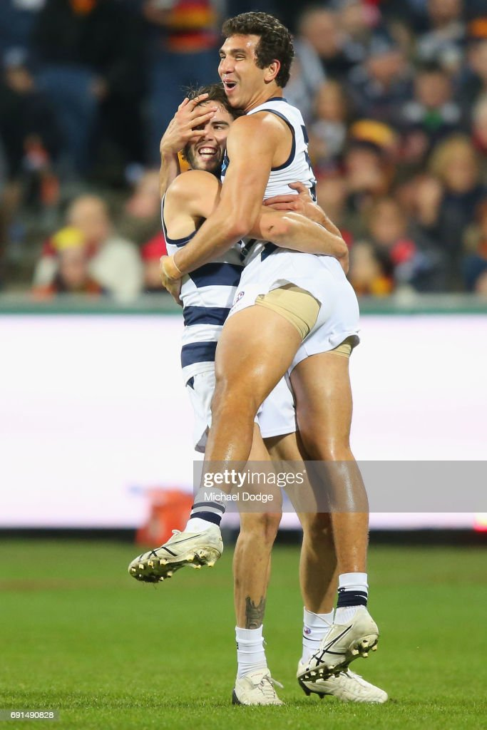 James Parsons of the Cats (L) and Nakia Cockatoo celebrates a goal during the round 11 AFL match between the Geelong Cats and the Adelaide Crows at Simonds Stadium on June 2, 2017 in Geelong, Australia.