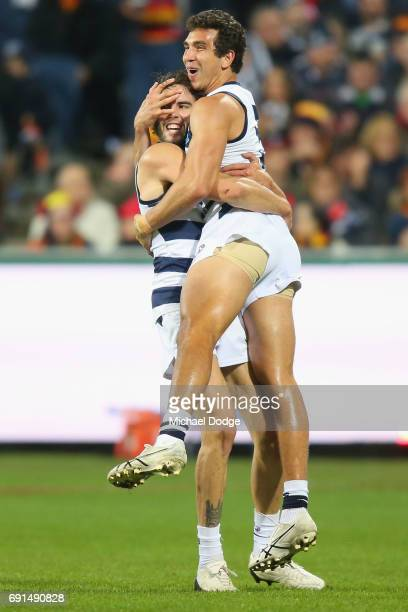 James Parsons of the Cats and Nakia Cockatoo celebrates a goal during the round 11 AFL match between the Geelong Cats and the Adelaide Crows at...
