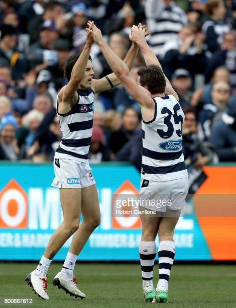 James Parsons of the Cats celebrates with Patrick Dangerfield after scoring a goal during the round 14 AFL match between the Geelong Cats and the...