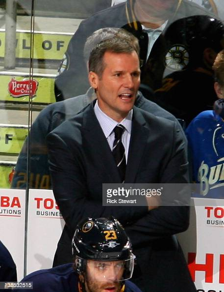 James Patrick stands on the Buffalo Sabres bench as acting head coach against the Boston Bruins at First Niagara Center on February 8 2012 in Buffalo...