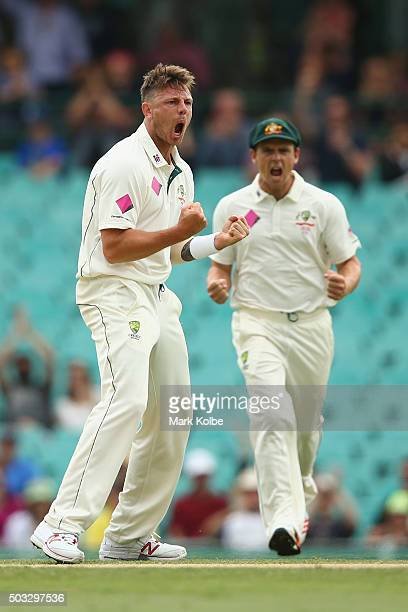 James Pattinson and Steve O'Keefe of Australia celebrate after Pattinson took to the wicket of Carlos Brathwaite of West Indies during day two of the...