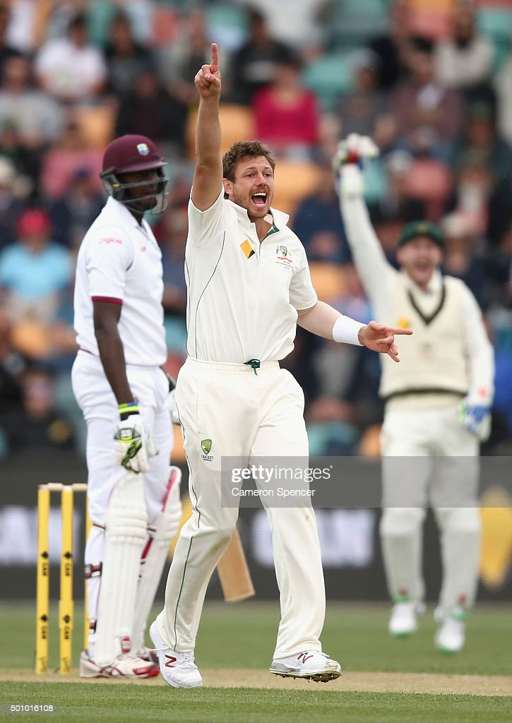 <a gi-track='captionPersonalityLinkClicked' href=/galleries/search?phrase=James+Pattinson&family=editorial&specificpeople=4884816 ng-click='$event.stopPropagation()'>James Pattinson</a> of Australia celebrates dismissing <a gi-track='captionPersonalityLinkClicked' href=/galleries/search?phrase=Jason+Holder&family=editorial&specificpeople=6681136 ng-click='$event.stopPropagation()'>Jason Holder</a> of the West Indies during day three of the First Test match between Australia and the West Indies at Blundstone Arena on December 12, 2015 in Hobart, Australia.