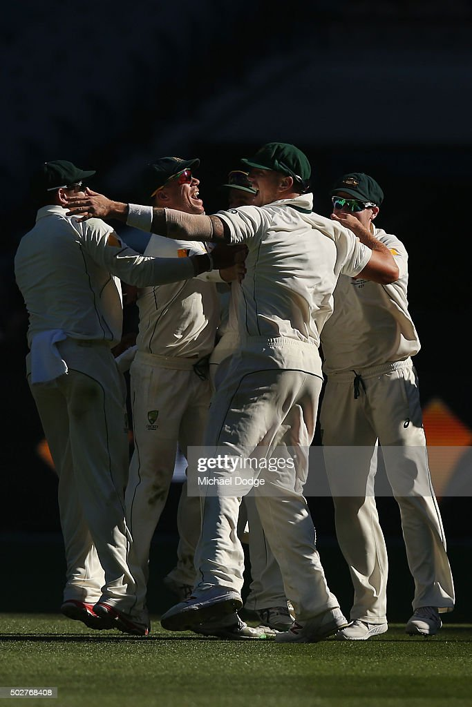 <a gi-track='captionPersonalityLinkClicked' href=/galleries/search?phrase=James+Pattinson&family=editorial&specificpeople=4884816 ng-click='$event.stopPropagation()'>James Pattinson</a> of Australia (R) celebrates taking the match winning catch with <a gi-track='captionPersonalityLinkClicked' href=/galleries/search?phrase=David+Warner+-+Cricket+Player&family=editorial&specificpeople=4262255 ng-click='$event.stopPropagation()'>David Warner</a> and teammates during day four of the Second Test match between Australia and the West Indies at Melbourne Cricket Ground on December 29, 2015 in Melbourne, Australia.
