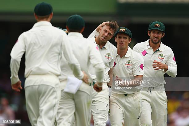 James Pattinson of Australia celebrates with Steve O'Keefe and Joe Burns of Australia after taking the wicket of Darren Bravo of West Indies during...