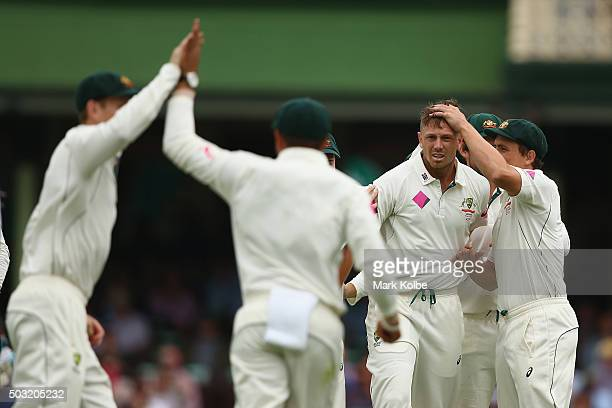 James Pattinson of Australia celebrates with Steve O'Keefe of Australia after taking the wicket of Darren Bravo of West Indies during day one of the...