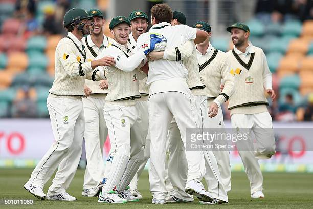 James Pattinson of Australia celebrates with team mates after dismissing Jermaine Blackwood of the West Indies during day three of the First Test...