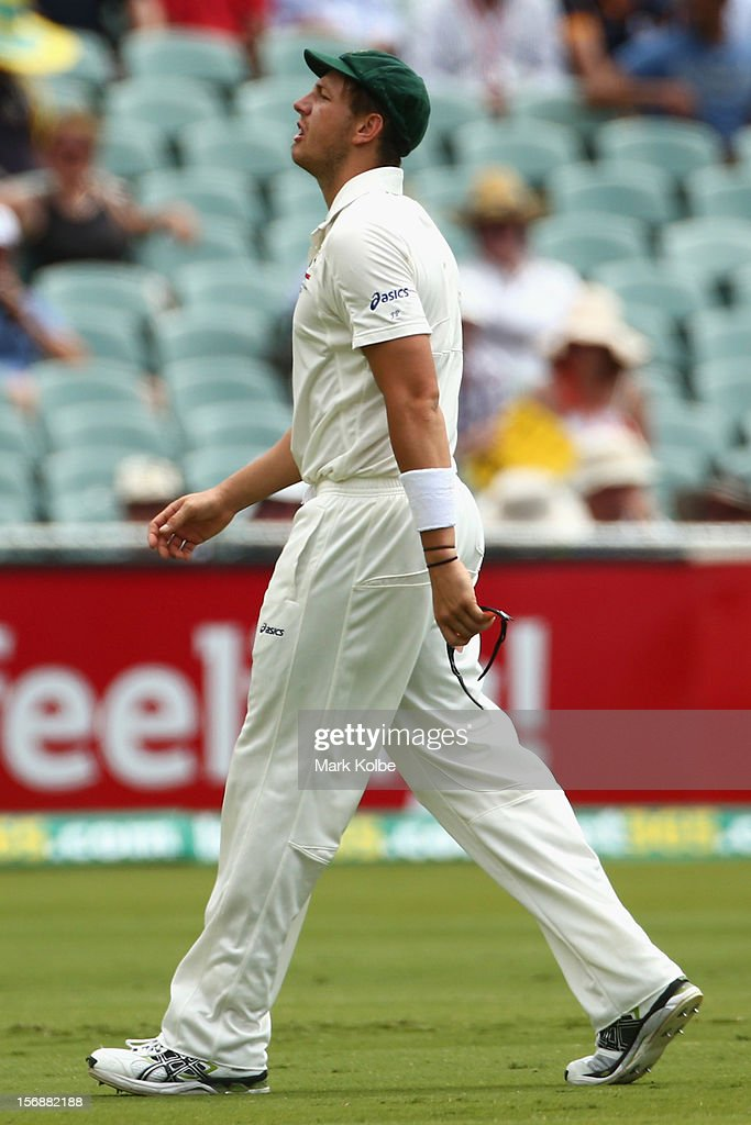 James Pattinson of Australia leaves the field with an injury after pulling up mid-way through an over during day three of the Second Test Match between Australia and South Africa at Adelaide Oval on November 24, 2012 in Adelaide, Australia.