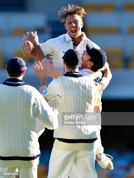 James Pattinson of the Bushrangers celebrates after taking his fifth wicket of the innings during the Sheffield Shield match between the Queensland...