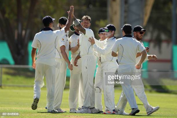 James Pattinson of the Bushrangers celebrates with his team mates after taking the wicket of Jason Behrendorff of the Warriors during the Sheffield...