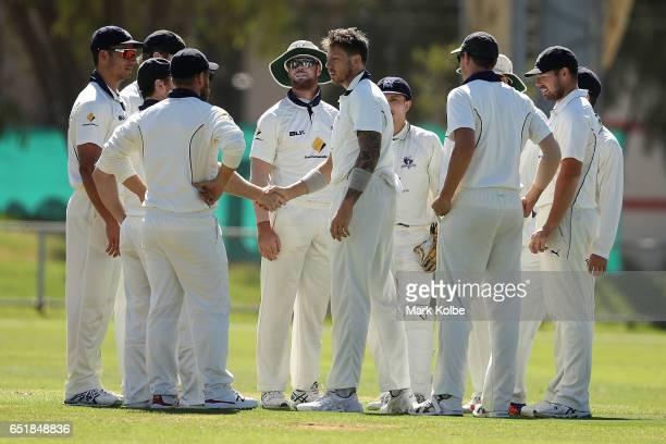 James Pattinson of the Bushrangers is congratulated by his team mates after taking his 5th wicket dismissing Jason Behrendorff of the Warriors during...