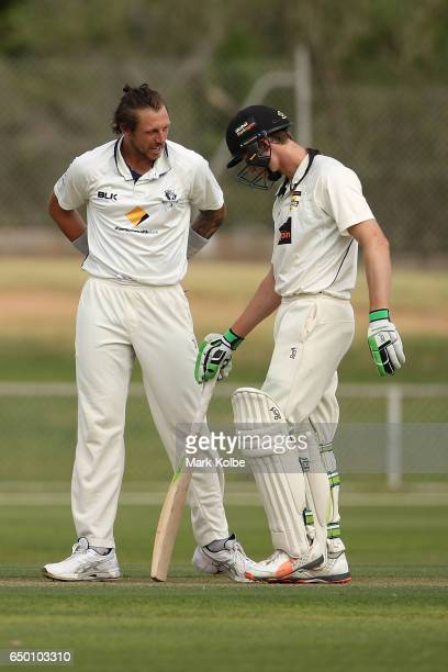 James Pattinson of the Bushrangers speaks to Cameron Bancroft of the Warriors during the Sheffield Shield match between Victoria and Western...