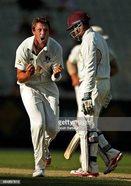 James Pattinson of Victoria celebrates after dismissing Usman Khawaja of Queensland during day three of the Sheffield Shield match between Victoria...