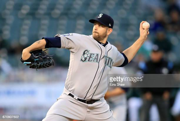 James Paxton of the Seattle Mariners pitches against the Oakland Athletics in the first inning at Oakland Alameda Coliseum on April 20 2017 in...